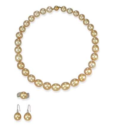 A group of South Sea golden cultured pearl jewellery. Including a necklace, of 31 golden cultured pearls measuring approximately 10.35 to 13.71 x 15.37 mm. Sold for HK$141,000 on 31 October 2000 at Christie's in Hong Kong