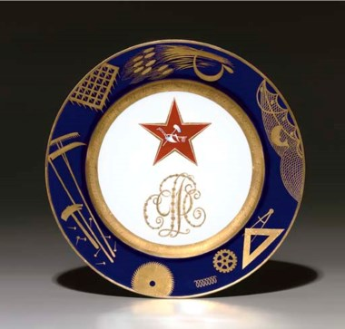 A Soviet propaganda porcelain plate, by the Imperial Porcelain Factory, period of Nicholas II, 1897, with later blue overglaze State Porcelain Factory jubilee mark of cog, V, hammer and sickle, dated 1922, numbered 21515. After a design by Mikhail Adamovich. Diameter9½ in (24.3 cm). Sold for £50,400 on 30 November 2005 at Christie's in London