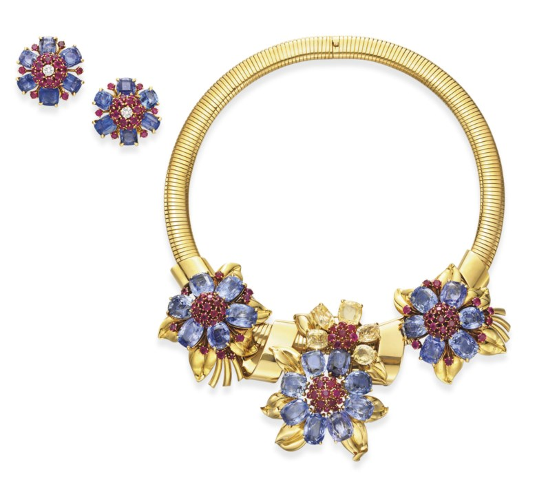 A suite of retro blue and yellow sapphire, ruby and gold Passe-Partout jewellery, by Van Cleef & Arpels. Sold for $86,500 on 15October 2008  at Christie's in New York