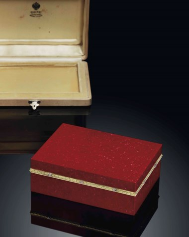 An important jewelled two-colour gold-mounted purpurine box marked Fabergé, circa 1913. 5¼  in (13.4  cm) wide. Sold for £481,875 on 3 June 2013 at Christie's in London