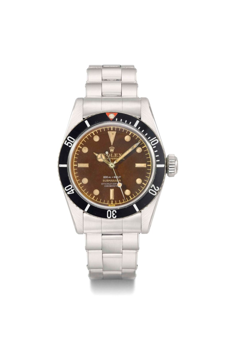 Rolex. A highly charismatic and extremely rare stainless steel automatic sweep centre seconds wristwatch with bracelet and brown-colored Four-Liner dial, signed Rolex, oyster perpetual, 200m=660ft, submariner, ref. 6538, case no. 449170, circa 1959. 37  mm  diam. Sold for CHF 519,750 on 13 May 2013 at Christie's in Geneva