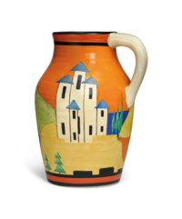 A CLARICE CLIFF (1899-1972) APPLIQUE ORANGE LUCERNE SINGLE HANDLED LOTUS JUG