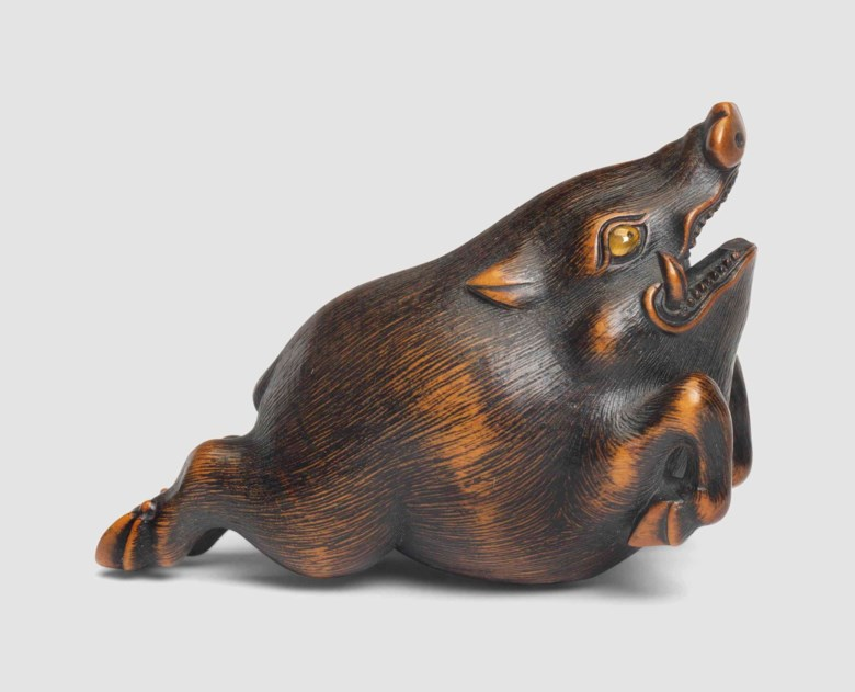A wood netsuke of a wild boar, signed Toyomasa (Naito Toyomasa, 1773-1856), Tamba, Edo period (early 19th century). 6.4  cm long. Sold for £17,500 on 8 December 2016 at Christie's in London