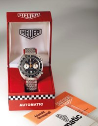Heuer. A Stainless Steel Chronograph Wristwatch with Date and Black Dial