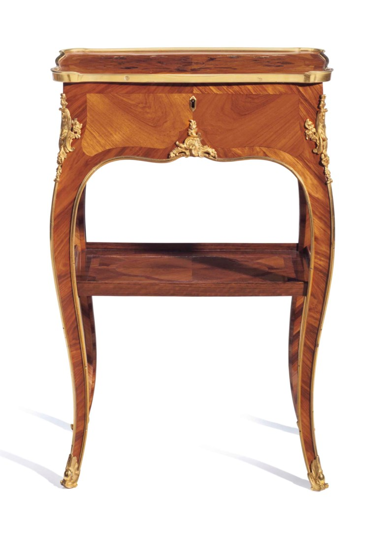 A Louis XV ormolu-mounted bois satine, tulipwood and amaranth bois de bout marquetry table en chiffonnière, by Bernard II van Risenburgh, circa 1750. 26½  in (67.3  cm) high, 17¼  in (43.8  cm) wide, 11¾  in (29.8  cm) deep. Sold for $93,750 on 14-15 June 2016 at Christie's in New York