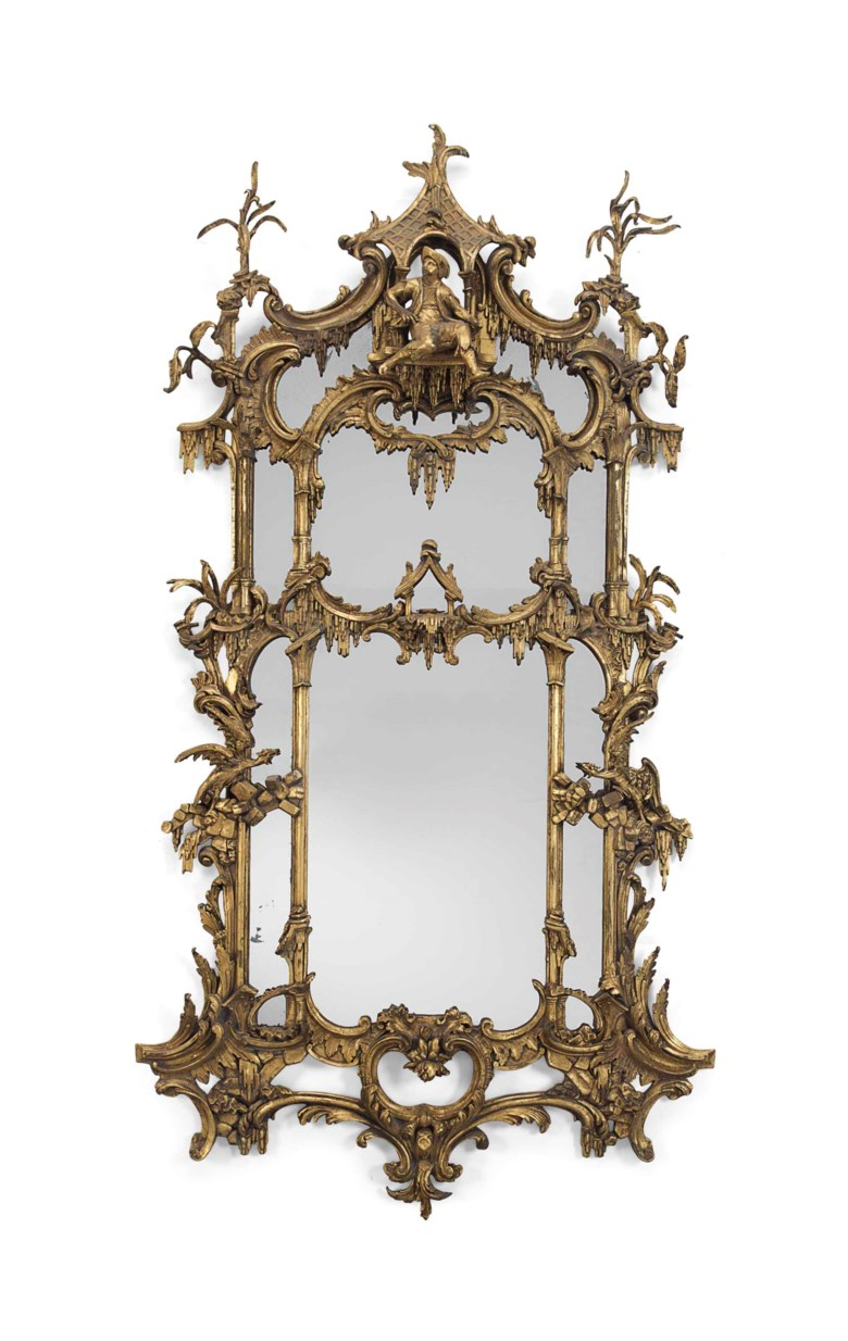 A George II-style giltwood and gilt-composition mirror, second half 19th century. 98 in (249 cm) high, 51 in (129.5 cm) wide. Sold for $8,750 on 5 April 2017  at Christie's in New York
