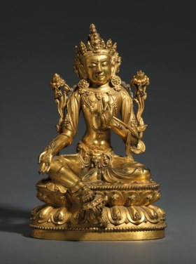 A RARE AND FINELY-CAST GILT-BRONZE SEATED FIGURE OF AVALOKIT