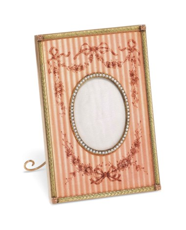 A jewelled two-colour gold-mounted and guilloché enamel photograph frame, marked Fabergé, with the workmaster's mark of Henrik Wigström, St Petersburg, 1904-1908, scratched inventory number 13588. 3¼  in (8.2  cm) high. Sold for £43,750 on 4 June 2018 at Christie's in London