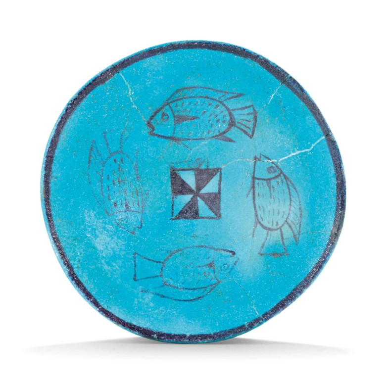 An Egyptian blue faience bowl, New Kingdom, 18th-19th dynasty, 1550-1186 B.C. Diameter 5⅞  in (15  cm). Estimate £15,000-20,000. Offered in Antiquities on 3 July 2018 at Christie's in London