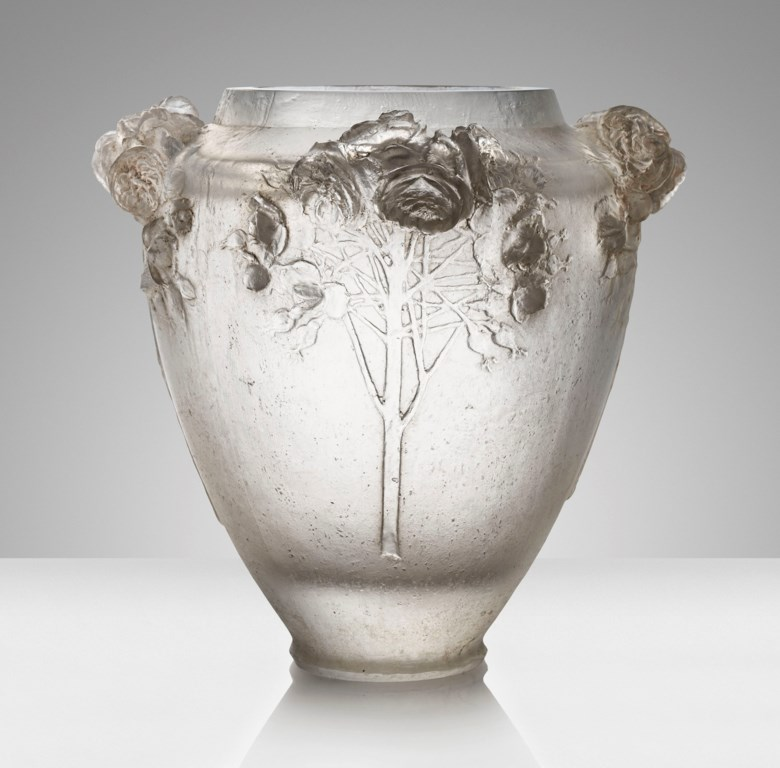 The largest René Lalique vase ever to be offered at auction 'Roses',arare and exceptional cire perdue vase, No. CP 48, designed 1913. 12⅜  in (31.4  cm) high. Estimate £300,000-500,000. This lot is offered in Design on 17 October 2018 at Christie's in London