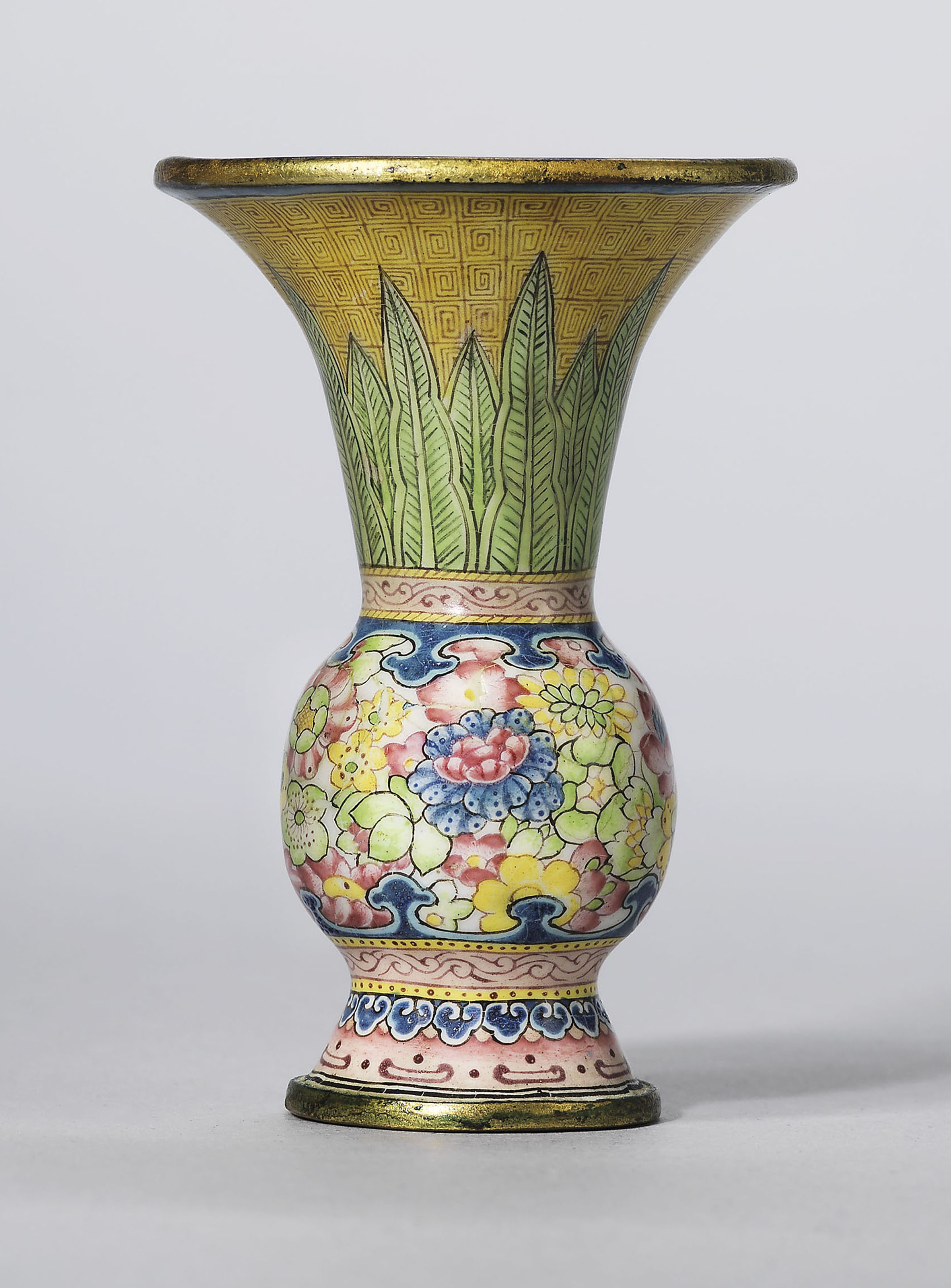 A rare painted enamel gu-shaped miniature vase, Qianlong four-character mark in blue enamel and of the period (1736-1795). 2½  in (6.4  cm) high. Sold for £60,000 on 15 May 2018 at Christie's in London