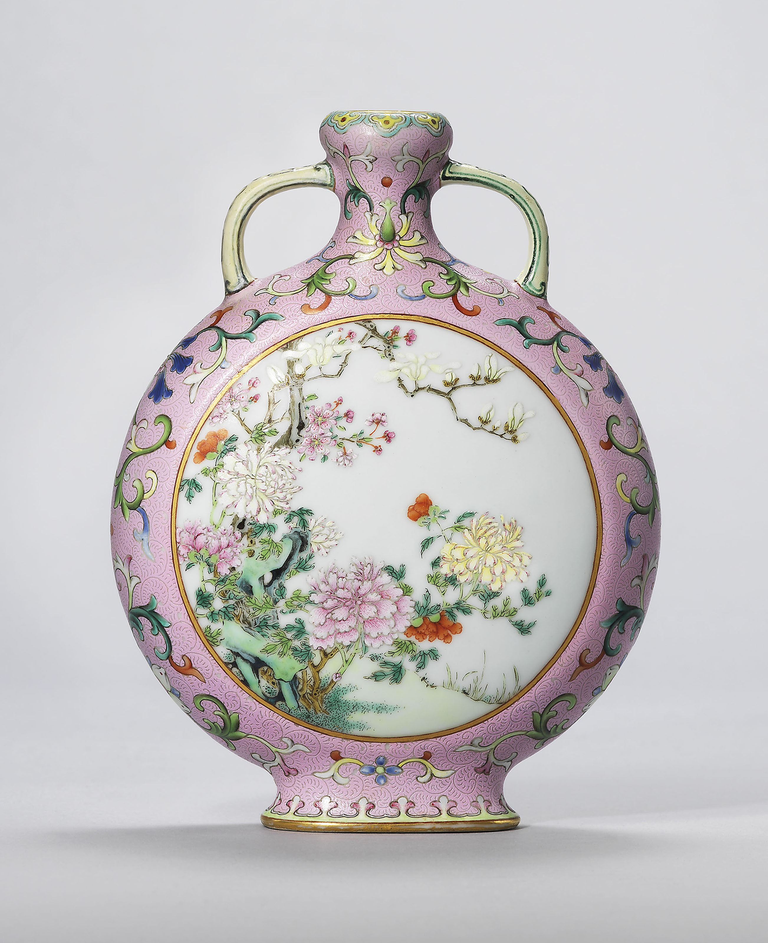 A rare and exceptional small pink-ground famille rose moonflask, Qianlong four-character seal mark in iron-red and of the period (1736-1795). 6⅛  in (15.5  cm) high.