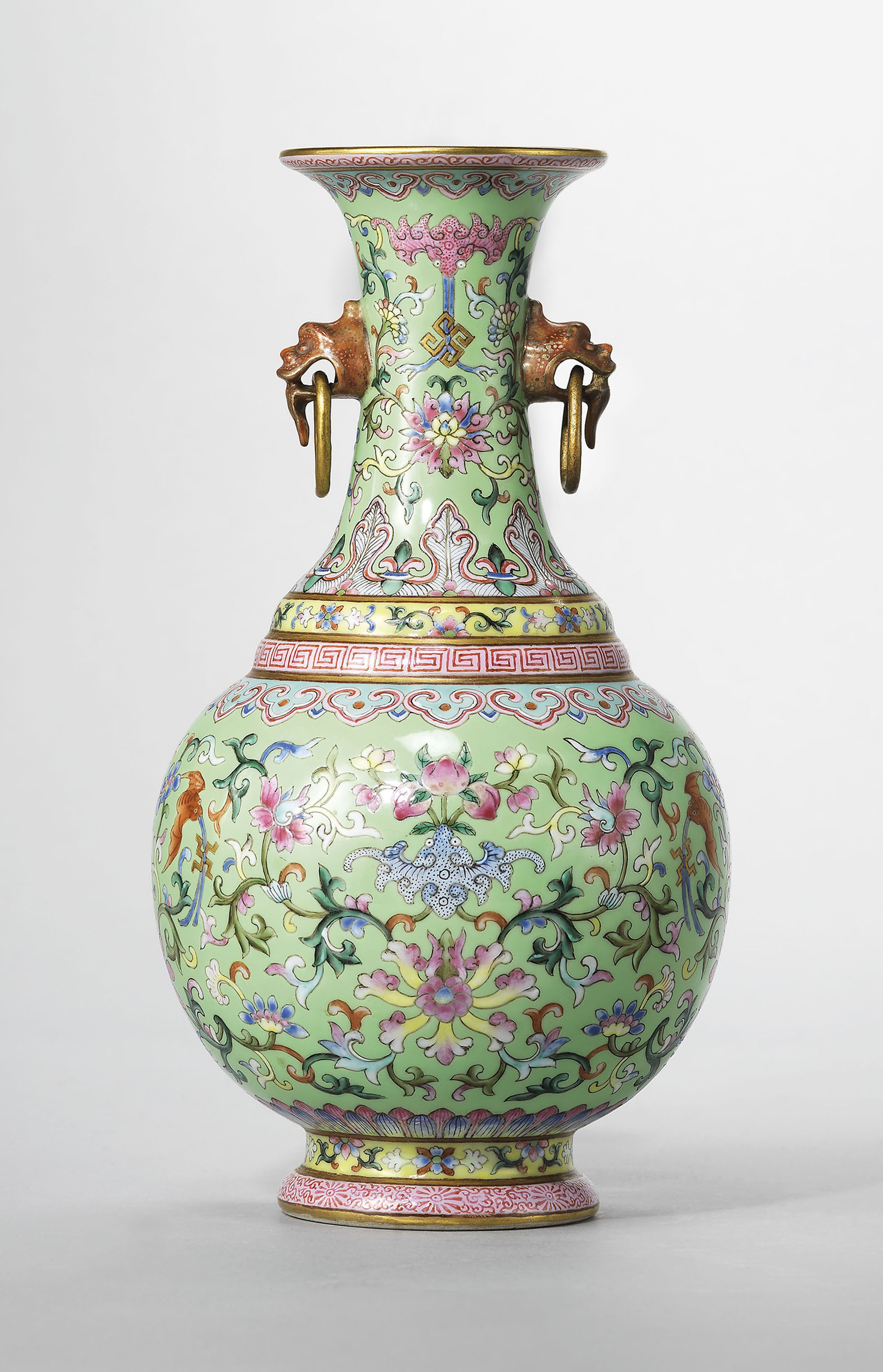 A lime-green ground famille rose twin-handled vase, Jiaqing six-character sealmark in iron-red and of the period (1796-1820). 7¾  in (19.8  cm) high. Sold for £112,500 on 15 May 2018 at Christie's in London