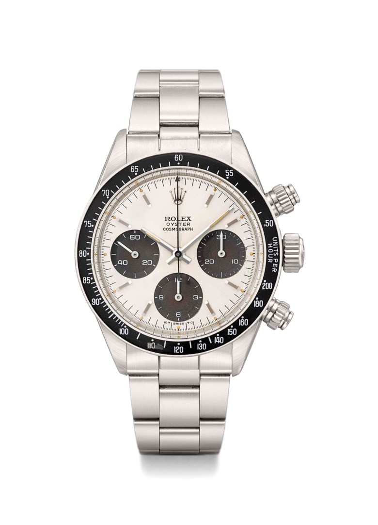 Rolex. A very fine and rare stainless steel chronograph wristwatch with bracelet and tropical sigma dial, Signed Rolex, Oyster Cosmograph, Daytona model, ref. 6263, Case no. 3'365'435, circa 1973.