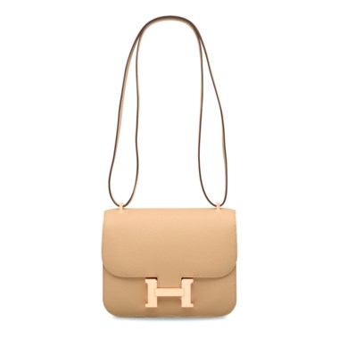 A trench & sable Epsom leather verso mini Constance 18 with permabrass hardware, Hermès, 2017. 18 w x 15 h x 4 d cm. Estimate HK$50,000-70,000. Offered in Handbags & Accessories  on 30 May at Christie's in Hong Kong The platonic ideal of a crossbody neutral, golden, compact, and distinctively Hermès.       .captiondesc { font-family LyonRegular, Arial, Helvetica,