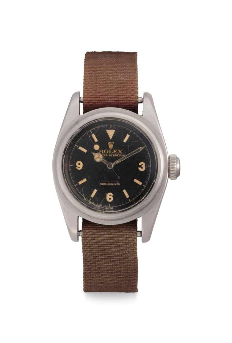 Rolex. A stainless-steel automatic wristwatch with centre seconds and gilt Explorer dial, Signed Rolex, Oyster Perpetual, 200660, Submariner, ref. 6538, case no. 140480, circa 1956. 37mm  diameter. Sold for $1,068,500 on 13 June 2018 at Christie's in New York