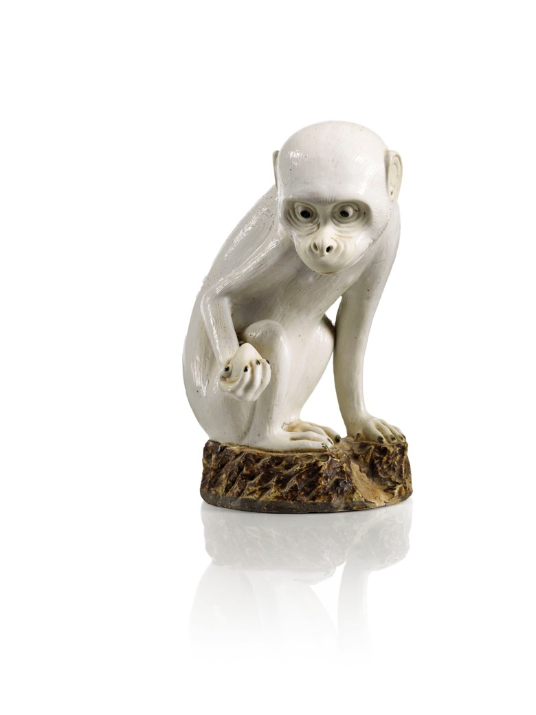 A white and brown-glazed biscuit figure of a monkey,China, Qing dynasty, Qianlong period (1736-1795). Height 22  cm (8¾  in). Sold for €112,500 on 13 June 2018 at Christie's in Paris