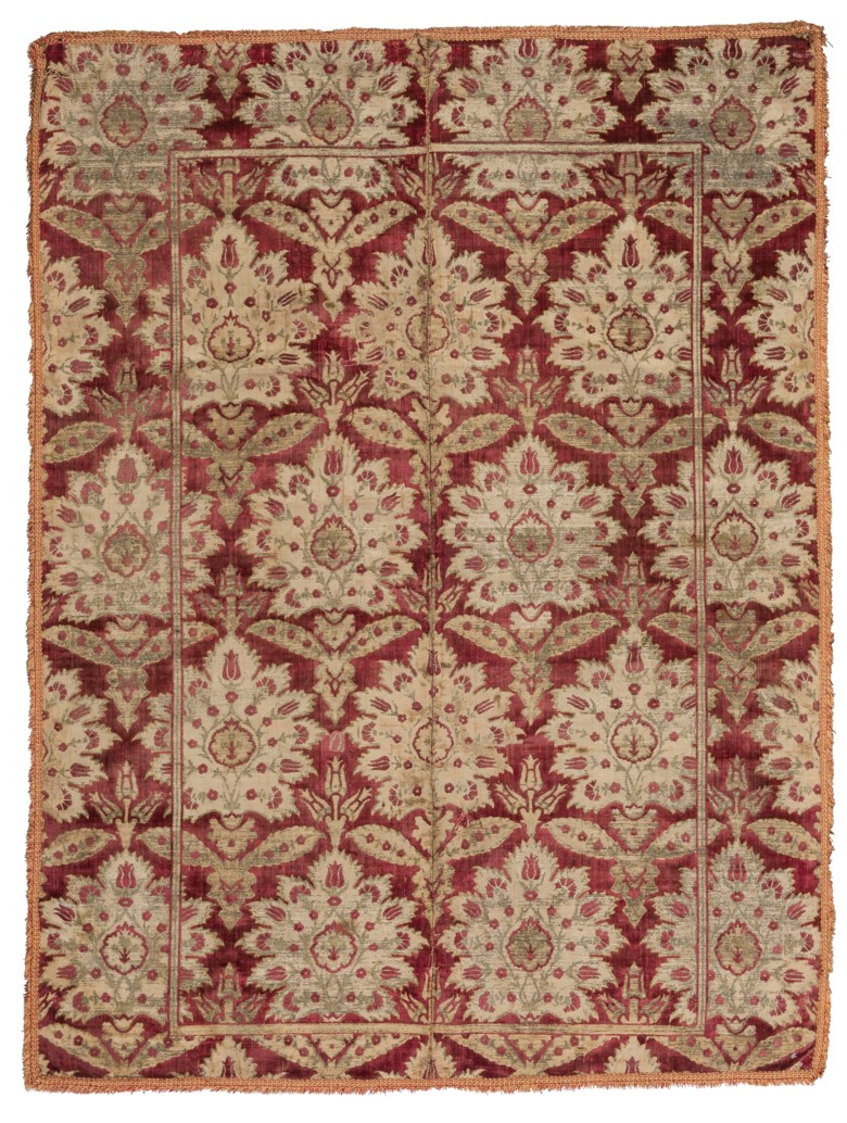 A large silk velvet and metal-thread panel, Bursa, Ottoman Turkey, 17th century. Dimensions 67⅜ x 50 in (171 x 127 cm). Estimate £20,000-30,000. Offered in Art of the Islamic and Indian Worlds Including Oriental Rugs and Carpets on 2 May 2019 at Christie's in London