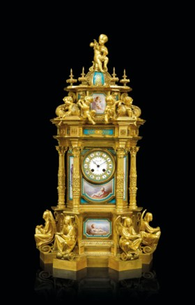 A FRENCH SEVRES-STYLE PORCELAIN-INSET ORMOLU MANTLE CLOCK