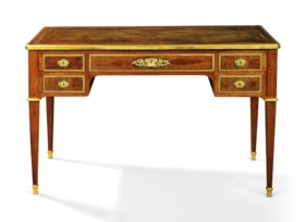 A FRENCH ORMOLU-MOUNTED MAHOGANY WRITING TABLE