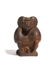 AN EGYPTIAN BROWN STEATITE BAB