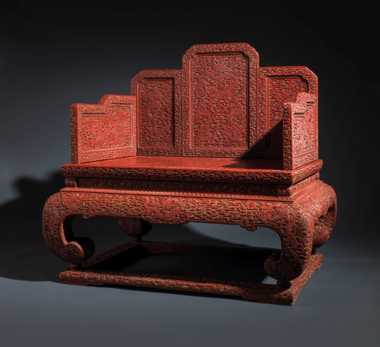 A very rare and magnificent imperial three-colour carved 'Nine Dragon' lacquer throne, Qianlong period (1736-1795). 43¼  in (111.1cm) high; 45½  in (115.5 cm) wide; 33¾  in (85.7 cm) deep. Estimate £800,000-1,200,000. Offered in Dragon Throne for the Son of Heaven on 14 May 2019 at Christie's in London