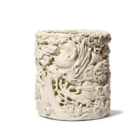 A CARVED BISCUIT PORCELAIN 'DRAGON' BRUSH POT