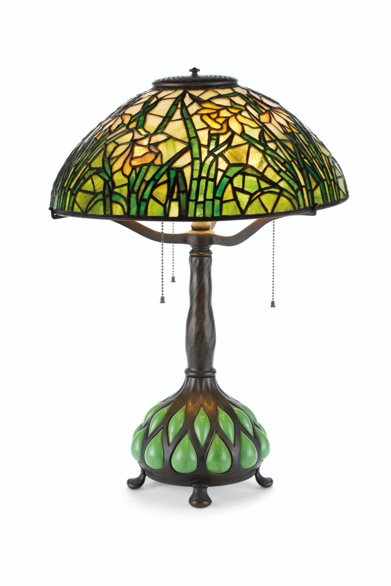Tiffany Studios,a 'Daffodil' table lamp, circa 1910. 16  in (40.6  cm) diameter; 23¾  in (60.4  cm) high. Estimate $10,000-15,000. This lot is offered in Interiors on 21-22 August 2019 at Christie's in New York