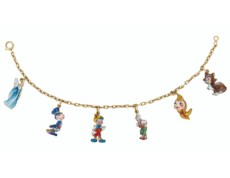 A WHIMSICAL ENAMEL AND GOLD PI