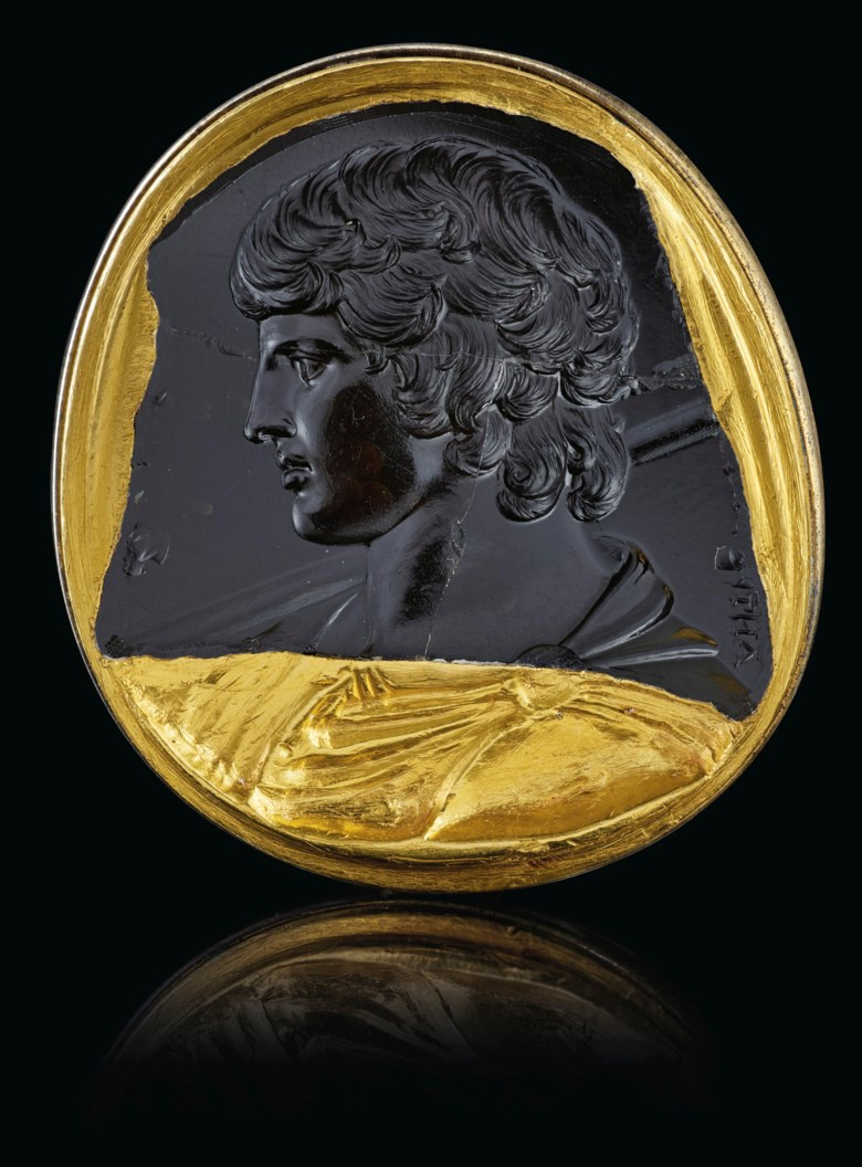 A Roman black chalcedony intaglio portrait of Antinous, circa 130-138 AD. 1⅜  in (3.4  cm) long. Sold for $2,115,000 on 29 April 2019 at Christie's in New York