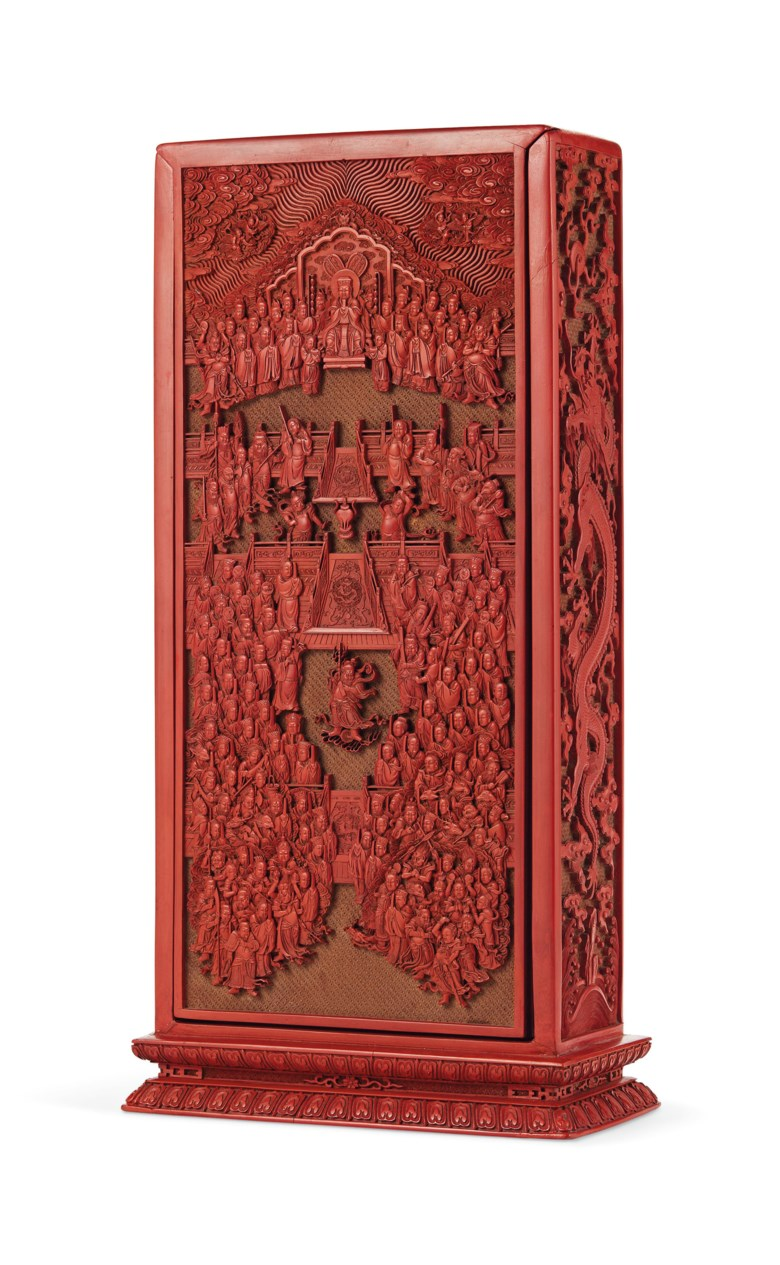 A rare and finely carved red lacquer Daoist scripture box and cover, China, Qing Dynasty, Qianlong period (1736-1795). 13½  in (33.9  cm) high. Sold for $1,035,000 on 20 March 2019 at Christie's in New York