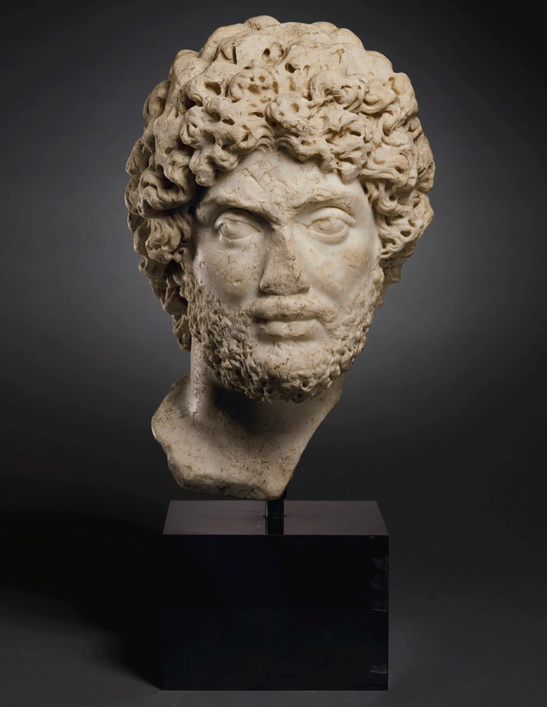 A Roman marble portrait head of a man, late Antonine to early Severan period, circa 180-195 AD. 15¾  in (40  cm) high. Estimate $400,000-600,000. Offered in Faces of the Past Ancient Sculpture from the Collection of Dr. Anton Pestalozzi on 28 October 2019 at Christie's in New York
