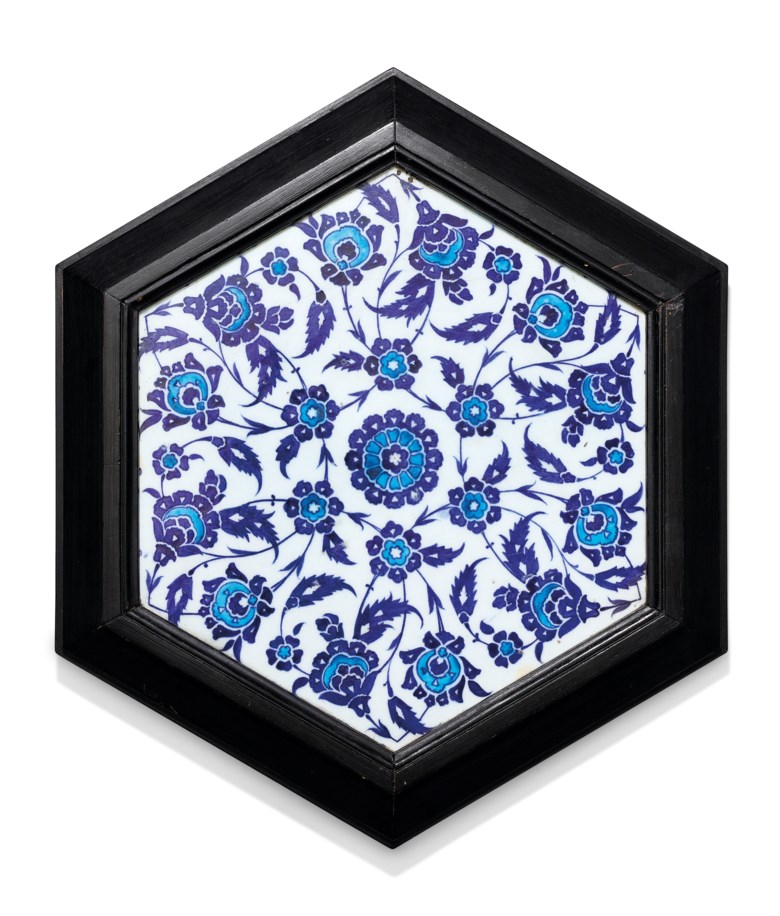 A blue and white hexagonal Iznik tile, Ottoman Turkey, circa 1530. 10½ in (26.5 cm) diam. Estimate £6,000-8,000. Offered in Art of the Islamic and Indian Worlds Including Oriental Rugs and Carpets on 2 April 2020 at Christie's in London