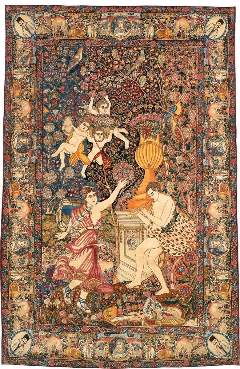 A signed Kirman pictorial carpet. Southeast Persia, circa 1900. Depicting a mythological scene with Bacchus and Ariadne, overall excellent condition. 10ft 9 in x 6ft 10 in (326 cm x 208 cm). This piece was offered in Oriental Rugs and Carpets on 19 April 2016 at Christie's in London and sold for £35,000