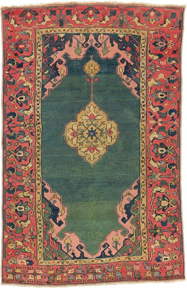 The green ground Hüelsman double-niche medallion Ushak rug. West Anatolia, late 16th century. 4ft 11 in x 3ft 2 in (150 cm x 97 cm). This piece was offered in Oriental Rugs and Carpets on 19 April 2016 at Christie's in London and sold for £72,100