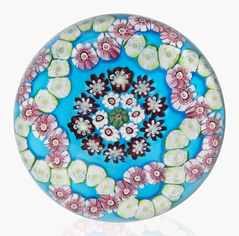A Clichy patterned millefiori colour-ground weight, mid-19th century. 3⅛ in (8 cm) diameter. Sold for $5,000 on 20 Apr 2016, Online