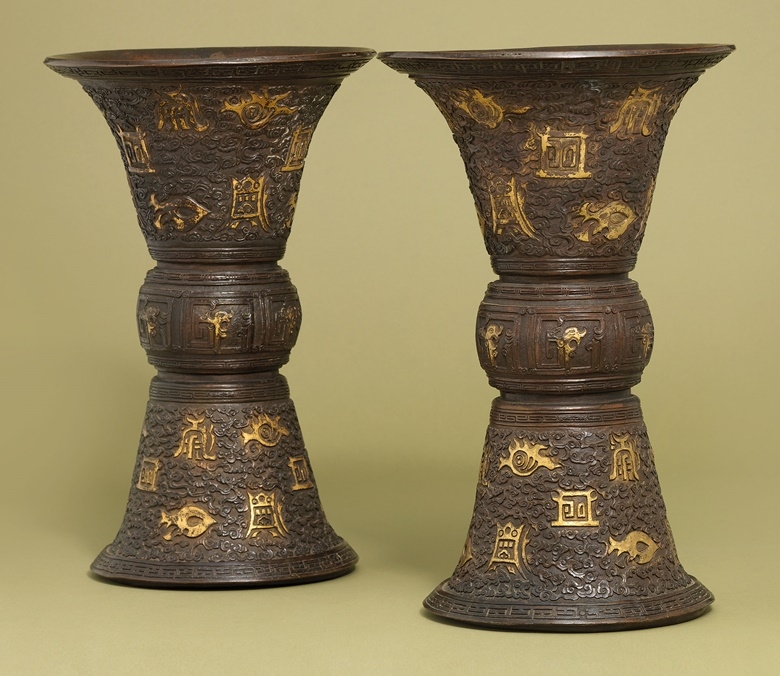 A pair of archaistic gilt-decorated bronze vases, Gu. Kangxi period (1622-1722). This work was offered in Inspired Themes a Fine Selection of Chinese Works of Art on 10 May 2016 at Christie's in London and sold for £17,500