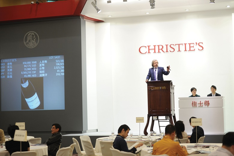 Nick Finch presides over a wine auction in Hong Kong