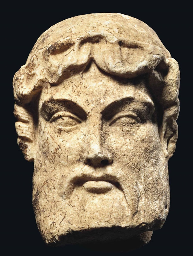 A Roman marble archaistic head of Hermes, circa 1st century BC. 5¼ in (13.5 cm) high. This lot was offered inAntiquitieson 6 July 2016 at Christie's in London, King Street