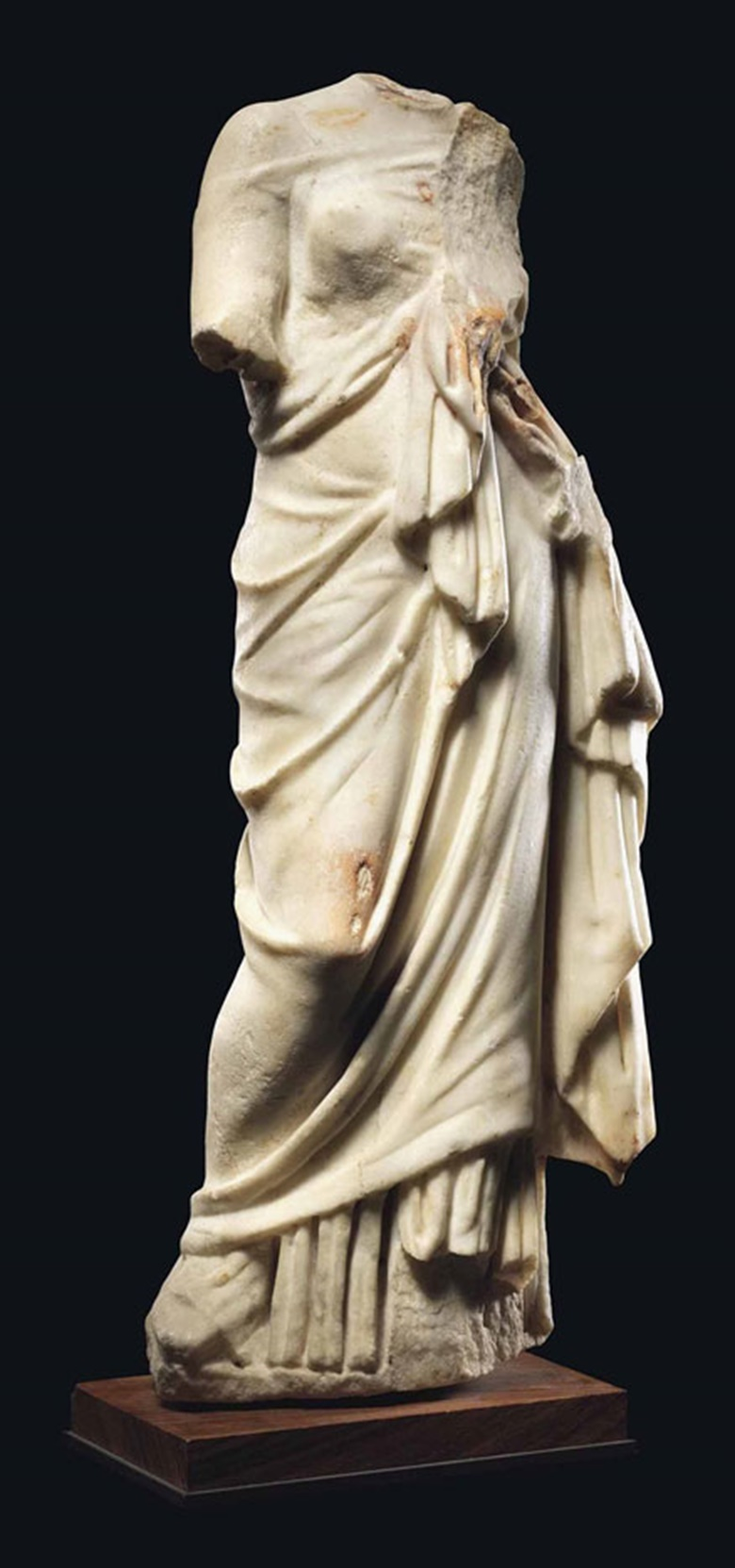 A Roman marble goddess, circa 2nd-3rd century AD. 22 in (56 cm) high. This lot was offered inAntiquitieson 6 July 2016 at Christie's in London, King Street and sold for £18,750