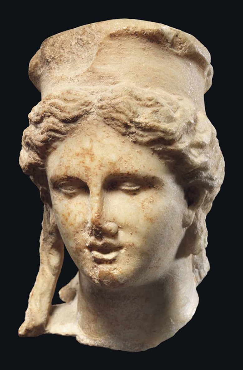A Roman marble head of Cybele, circa 1st century BC-1st century AD. 5⅛ in (13 cm) high. This lot was offered inAntiquitieson 6 July 2016 at Christie's in London, King Street and sold for £15,000