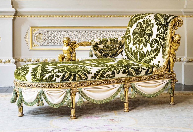 A French giltwood chaise longue by Henri-Auguste Fourdinois, Paris, circa 1878. Covered with green and cream-coloured cut silk velvet, the back of outscrolled form with one arm supported by a kneeling putto, the rounded base on seven column-form legs separated by fabric swags. 41½ in (105.5 cm) high; 75¾ in (192.5 cm) wide; 34¼ in (87 cm) deep. Sold for £47,500 on 7 June