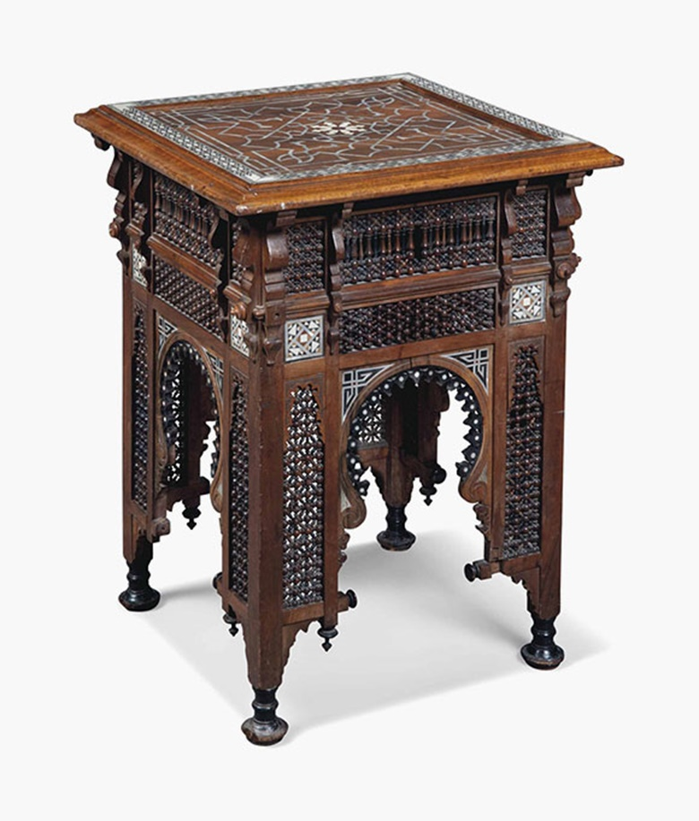 A 'Moorish' ivory and mother-of-pearl-inlaid hardwood and ebonised occasional table, circa 1900. 29 in (74 cm) high; 21½ in (55 cm) square. Sold for £2,125 on 20 July 2016