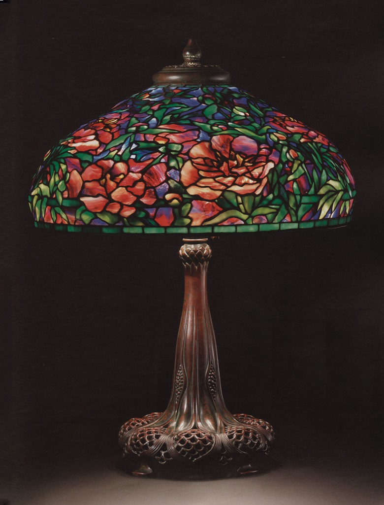 Tiffany Studios, An elaborate 'Peony' leaded glass and bronze table lamp, circa 1915. 29½ in (75 cm) high, 22¼ in (56.4 cm) diameter of shade. Sold for $1,538,500 on 8 December 2009