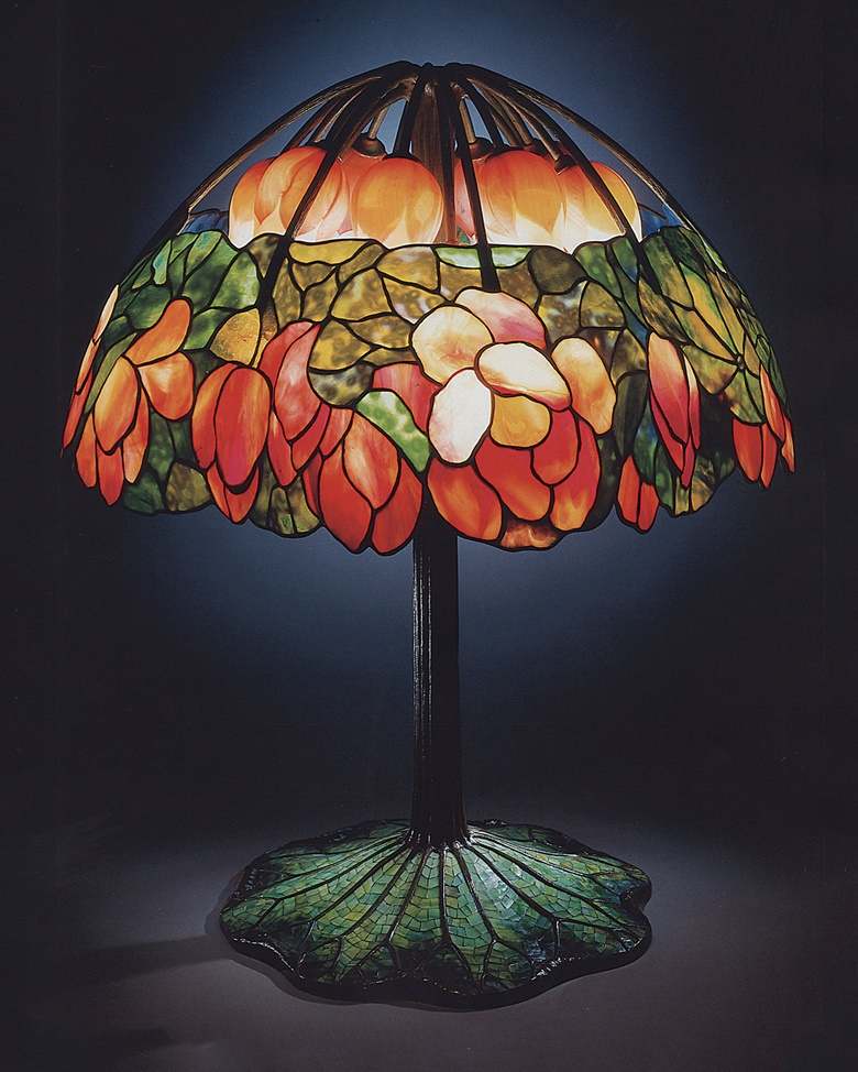 Tiffany Studios, A leaded glass, bronze and mosaic 'Lotus' lamp, circa 1900-10. 34¾ in (88.3 cm) high, 28 in (71.1 cm) diameter. Sold for $2,807,500 on 12 December 1997 (World record for any work of Tiffany Studios)