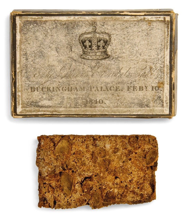 Queen Victoria (1819-1901). A slice of wedding cake, 1840. In presentation box, inscribed 'The Queens Bridal Cake BUCKINGHAM PALACE, FEBY. 10 1840', beneath a Royal crown; together with Queen Victoria's signature on paper with Royal cypher. Estimate £800-1,200. This lot is sold with a letter from the Royal Archives at Windsor Castle relating to the cake, and is offered in