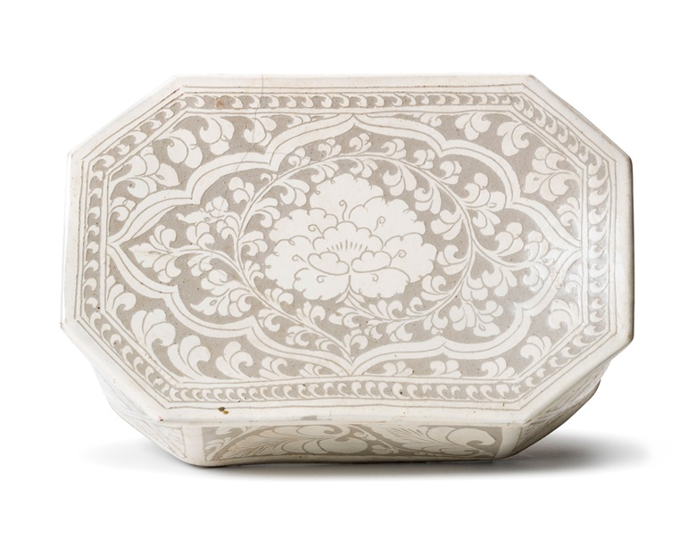 A Cizhou sgraffito 'peony' octagonal pillow. Northern Song dynasty (960-1127). 11⅛ (28.2 cm) wide. Sold for HK$56,250 11 October 2017, Online