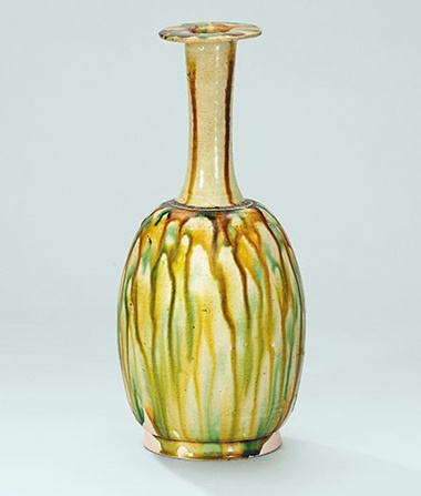 A sancai-glazed bottle  vase. Tang dynasty (618-907). 9 in (23 cm) high.  This work was offered in The Pavilion Sale on 4 October 2016 at Christie's Hong Kong and sold for HK$112,500$US14,600