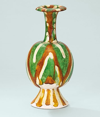 A sancai-glazed vase. Tang dynasty (618-907). 9½ in (24 cm) high. This work was offered in The Pavilion Sale on 4 October 2016 at Christie's Hong Kong and sold for HK$437,500$US56,700