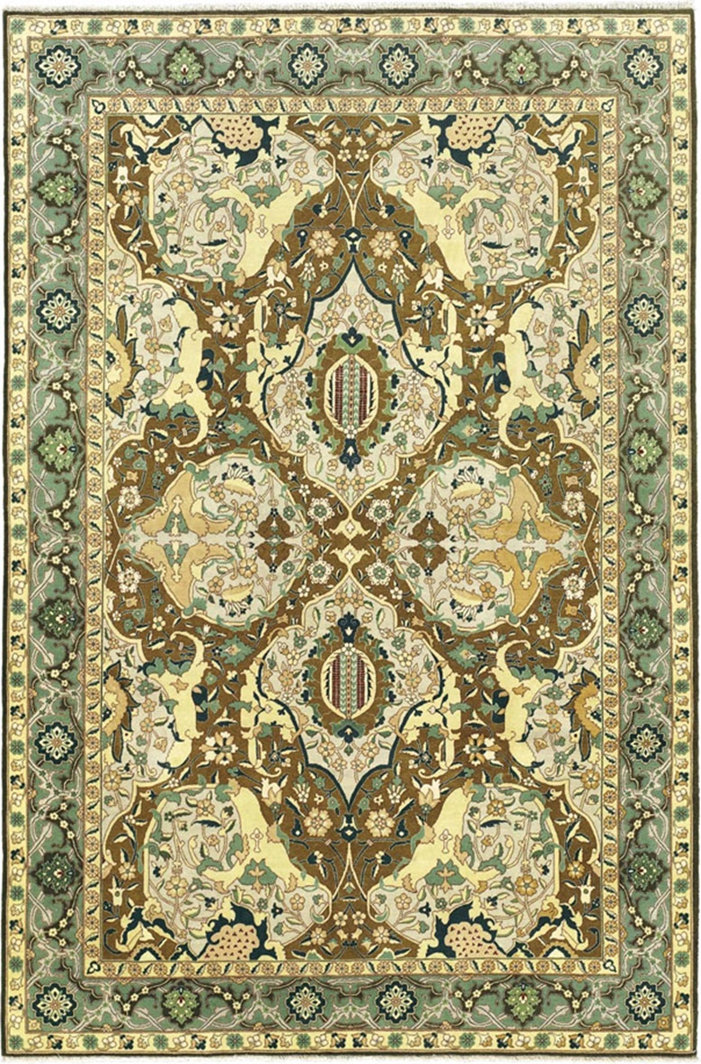 A Tabriz carpet. Northwest Persia, c.  1930. 9 ft 2 in x 6 ft 1 in (278 cm x 184 cm). This lot was offered in Oriental Rugs and Carpets on 18 October 2016 at Christie's in London, King Street and sold for £5,625